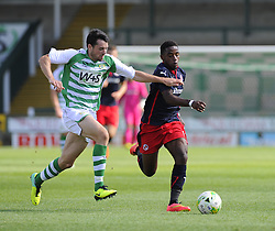 Yeovil Town's Brendon Maloney battles for the ball with Reading's Tarique Fosu - Photo mandatory by-line: Joe Meredith/JMP - Mobile: 07966 386802 19/07/2014 - SPORT - FOOTBALL - Yeovil - Huish Park - Yeovil Town v Reading