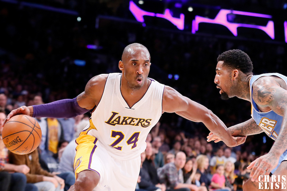 23 November 2014: Los Angeles Lakers guard Kobe Bryant (24) drives past Denver Nuggets forward Wilson Chandler (21) during the Denver Nuggets 101-94 overtime victory over the Los Angeles Lakers, at the Staples Center, Los Angeles, California, USA.
