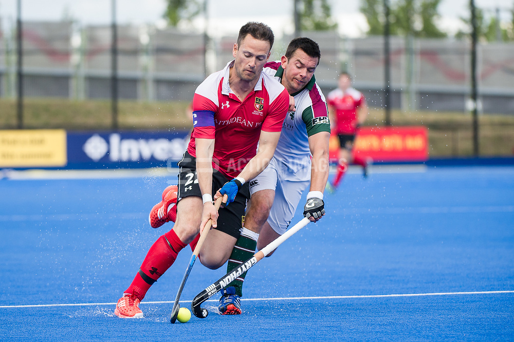 Holcombe's Richard Lane goes round William Marshall of Surbiton. Holcombe v Surbiton - Semi-Final - Men's Hockey League Finals, Lee Valley Hockey & Tennis Centre, London, UK on 22 April 2017. Photo: Simon Parker