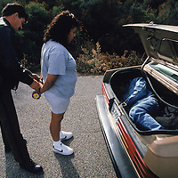 A smuggler is arrested in California, after four people were found in the trunk of her car on a road used to bypass a checkpoint installed during operation Gatekeeper. A 1997 study by the University of Houston attributed rise in undocumented migrant deaths to Operation Gatekeeper. Please contact Todd Bigelow directly with your licensing requests. PLEASE CONTACT TODD BIGELOW DIRECTLY WITH YOUR LICENSING REQUEST. THANK YOU!