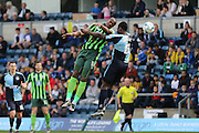 both Tom Elliott forward for AFC Wimbledon (9) and Wycombe Wanderers defender Aaron Pierre (6) jump for the ball during the Sky Bet League 2 match between Wycombe Wanderers and AFC Wimbledon at Adams Park, High Wycombe, England on 2 April 2016. Photo by Stuart Butcher.