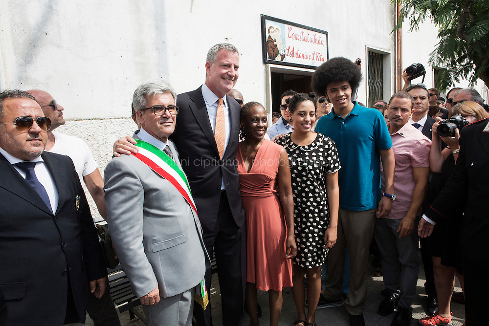 GRASSANO, ITALY - 24 JULY 2014: Mayor of New York Bill de Blasio and his family pose for a picture with Mayor of Grassano Francesco San Severino (left of de Blasio) in Grassano, his ancestral home town in Italy, on July 24th 2014.<br /> <br /> New York City Mayor Bill de Blasio arrived in Italy with his family Sunday morning for an 8-day summer vacation that includes meetings with government officials and sightseeing in his ancestral homeland.