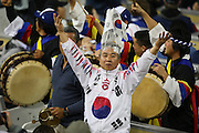 LOS ANGELES, CA - MARCH 23: A fan of Korea wears a costume and fires up the fans against Japan in the final game of the 2009 World Baseball Classic at Dodger Stadium in Los Angeles, California on Monday March 23, 2009. Japan defeated Korea 5-3 in ten innings. (Photo by Paul Spinelli/WBCI/MLB Photos)