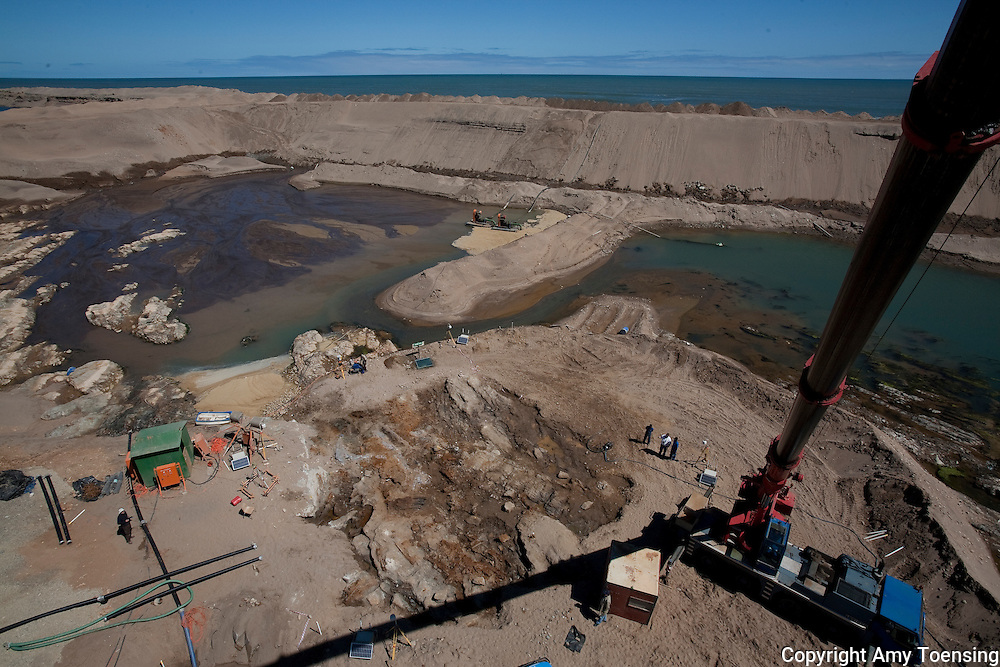 ORANJEMUND, NAMIBIA -- SEPTEMBER 26: Views from a crane of the site of what scientists presume to be an early 1500s, Portuguese shipwreck off the Namibian coast on September 26, 2008 in Oranjemund, Namibia. The wreck was discovered by miners in the Namdeb diamond mine off the coast of Namibia. The ship was found seven meters below sea level on April 1, 2008. Most of the the artifacts found are being stored in a storage shed at the Namdeb Diamond Mine. Items include: copper ingots, bronze canons, canon balls, pewter bowls and plates, ivory tusks from African elephants, and most substantial over 2000 gold coins- approximately 21 kg - the most gold found in Africa since the Valley of the Kings in Egypt. (Photo by Amy Toensing) _________________________________<br /> <br /> For stock or print inquires, please email us at studio@moyer-toensing.com.