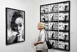 "London, UK.  17 May 2017. A visitor views ""Smoke and Veil, Paris"" (Vogue), 1958, by William Klein.  Preview of Photo London 2017 at Somerset House.  Held for the third time, the event showcases the best in contemporary photography, from 89 galleries from 16 different countries, for collectors and enthusiasts and will be on from 18 - 21 May. Credit: Stephen Chung / Alamy Live News"