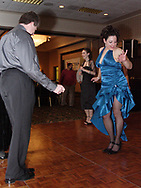 Gina Stough (right) takes a break from singing with Son del Caribe to do some dancing at the 17th Artemis Center Gala, Saturday night.