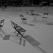 Lonely chairs in the snow of a Park in New York