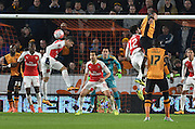 Gabriel Paulista of Arsenal FC (5) deflects the ball away from the goal during the The FA Cup fifth round match between Hull City and Arsenal at the KC Stadium, Kingston upon Hull, England on 8 March 2016. Photo by Ian Lyall.