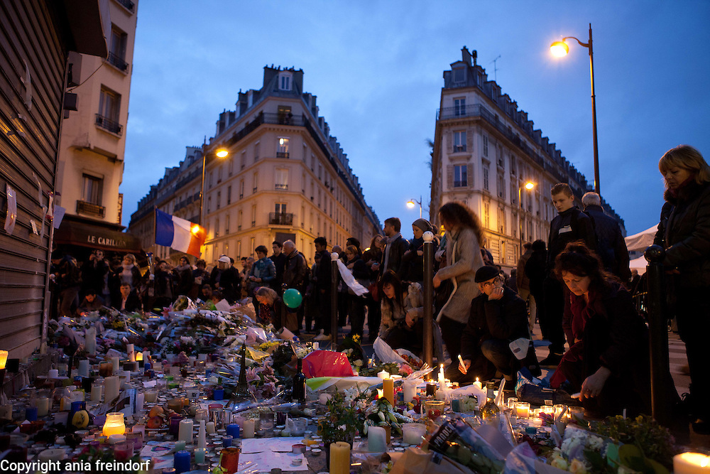 "Paris Terrorist Attacks, people Mourning in front of Bar ""Le Carillon"" and Restaurant ""Le Petit Cambodge"", where 15 people died from Kalashnikov shooting on 13/11/15. french flag"