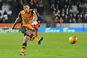 Hull City midfielder Jake Livermore (14) kicks towards goal  during the Sky Bet Championship match between Hull City and Charlton Athletic at the KC Stadium, Kingston upon Hull, England on 16 January 2016. Photo by Ian Lyall.