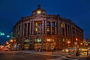 South Station is the major train station in boston where amtrak, mbta trains and buses converge and is located on the corner of Atlantic Ave and Summer St. in Boston.  Built in 1899 in the heart of Boston's financial district this granite behomoth was designed by Shepley, Rutan and Cooledge architectual firm..700 Atlantic Ave, Dewey Square, Boston. At night the city's urban landscape is lit and takes on a vibrant dimention.  In these impressions of everyday scenes the artist highlights the bricks, morter and steal that we pass every day but rarely see. The series called Boston Noir is intentionally gritty and edgy like the city at night.