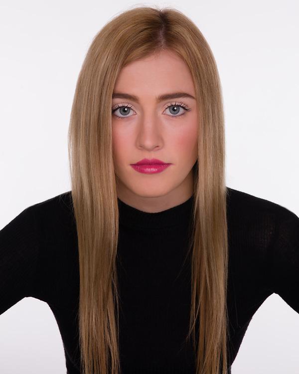 Quirky, symmetrical headshot of Houston model and actess Savannah O'Hara.