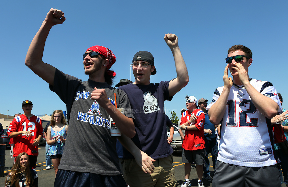"(Foxboro, MA - 5/24/15) Kevin Aldrich, left, Nick Pacitti, and Alex Pacitti, all of Foxboro, cheer during the ""Free Tom Brady"" rally at Gillette Stadium, Sunday, May 24, 2015. Staff photo by Angela Rowlings."