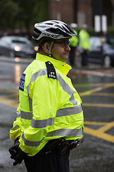 © Licensed to London News Pictures. 27/05/2014. London, UK. A Police Officer at an Operation Safeway road safety event held at the junction of Tooley Street and Tower Bridge Road in London on 27th May 2014. A seven week pilot of Operation Safeway was carried out late last year in response to a series of tragic cyclist and pedestrian deaths on London's roads, where Police officers were deployed at key junctions across the capital, enforcing road safety and giving advice to road users during rush hours. Operation Safeway will now continue at key junctions across London to build awareness and promote safety for all road users. Photo credit : Vickie Flores/LNP