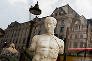 A cast copy of a classical ancient Greek statue of Apollo in a shop window near Piccadilly Circus, on 30th April 2019, in London, England