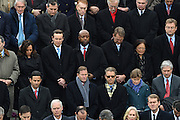 Senators including Rand Paul, lower right, Richard Blumenthal, lower center, Tim Scott, center, Ted Cruz, upper left, Chris Murphy, center left, and Edward Markey, top left, watch the 68th Inaugural ceremony January 20, 2017 in Washington, DC. Donald Trump became the 45th President  of the United States of America.