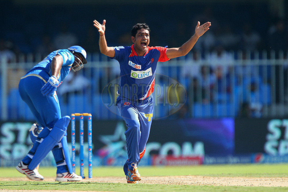 Laxmi Ratan Shukla of the Delhi Daredevils appeals for the wicket of Kieron Pollard of the Mumbai Indians during match 16 of the Pepsi Indian Premier League 2014 between the Delhi Daredevils and the Mumbai Indians held at the Sharjah Cricket Stadium, Sharjah, United Arab Emirates on the 27th April 2014<br /> <br /> Photo by Ron Gaunt / IPL / SPORTZPICS