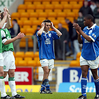 St Johnstone v Hibs   12.05.02<br />Paul Hartley leaves the field after his team lost to Hibs....Is it his final game for St Johnstone<br /><br />Pic by Graeme Hart<br />Copyright Perthshire Picture Agency<br />Tel: 01738 623350 / 07990 594431