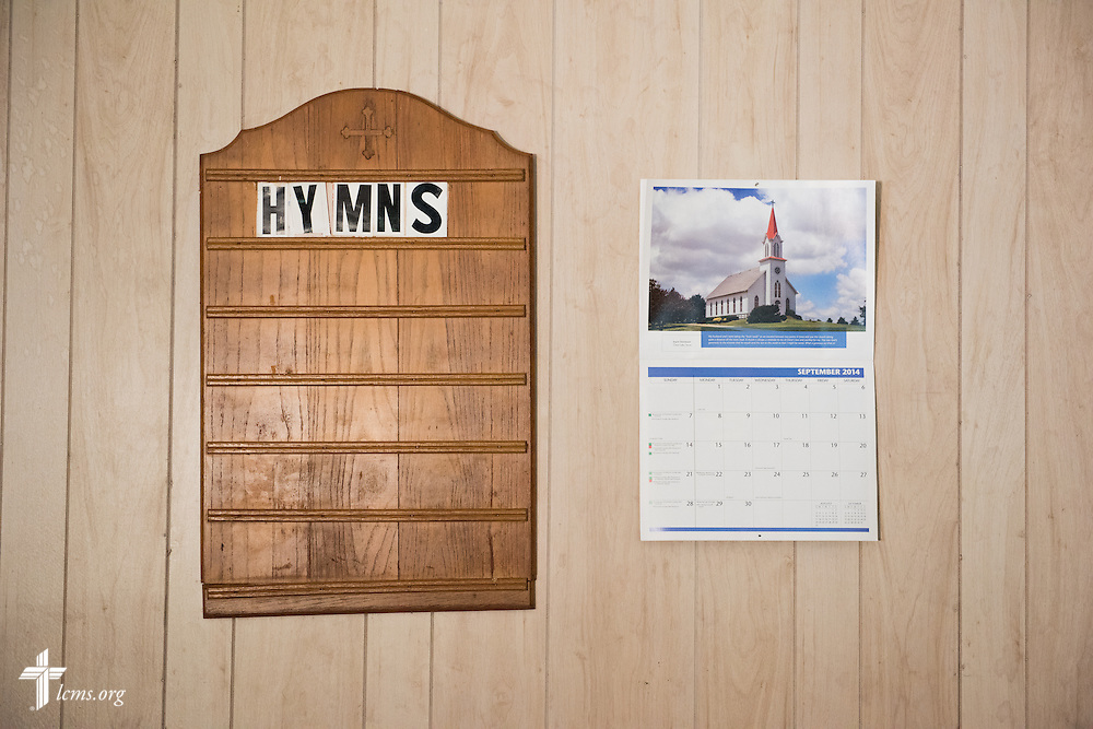 The hymn board contrasts against a calendar near the altar of Hope Lutheran Church during 'The First Rosa' filming on Wednesday, Sept. 24, 2014, outside Selma, Ala. LCMS Communications/Erik M. Lunsford
