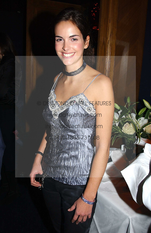 MISS OCTAVIA KHASHOGGI at a party hosted by Tatler magazine to celebrate the publication of the 2004 Little Black Book held at Tramp, 38 Jermyn Street, London SW1 on 10th November 2004.<br />