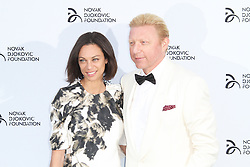 © Licensed to London News Pictures. Lily Becker and Boris Becker at the Novak Djokovic Foundation London gala dinner, The Roundhouse, London UK, 08 July 2013. Photo credit: Richard Goldschmidt/LNP