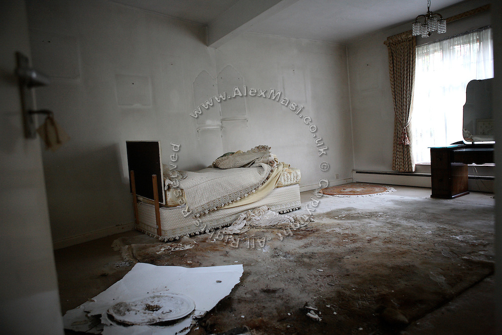One of the rooms in the Wildwood Road mansion is photographed moments after the squatters entered the house for the first time, on Friday, June 15, 2007, in Hampstead, London, England. Situated opposite Hampstead Heath, North London's green jewel the average price for properties on this road reaches £ 2,500,000. Million Dollar Squatters is a documentary project in the lives of a peculiar group of squatters residing in three multi-million mansions in one of the classiest residential neighbourhoods of London, Hampstead Garden. The squatters' enthusiasm, their constant efforts to look after what has become their home, their ingenuity and adventurous spirit have all inspired me throughout the days and nights spent at their side. Between the fantasy world of exclusive Britain and the reality of squatting in London, I have been a witness to their unique story. While more than 100.000 properties in London still lay empty to this day, squatting provides a valid, and lawful alternative to paying Europe's most expensive rent prices, as well as offering the challenge of an adventurous lifestyle in the capital.