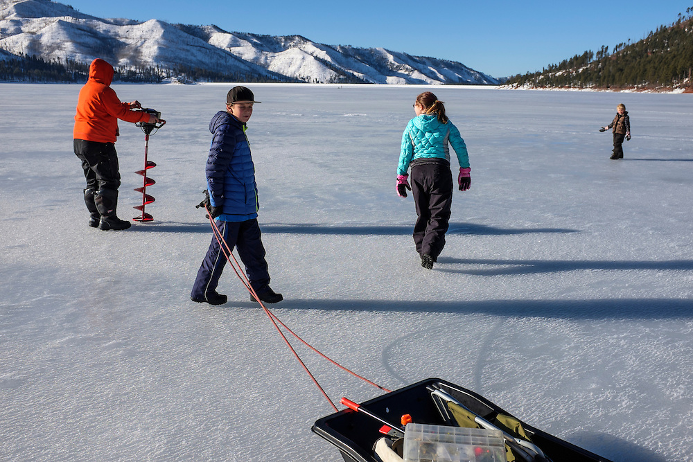 Colorado family preparing for a day of icefishing on the Vallecito reservoir, Southwest Colorado