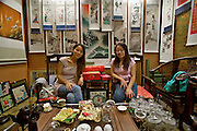 Wangfujing Dajie shopping street and pedestrian zone. Tea house and traditional art gallery, with roll images for sale.