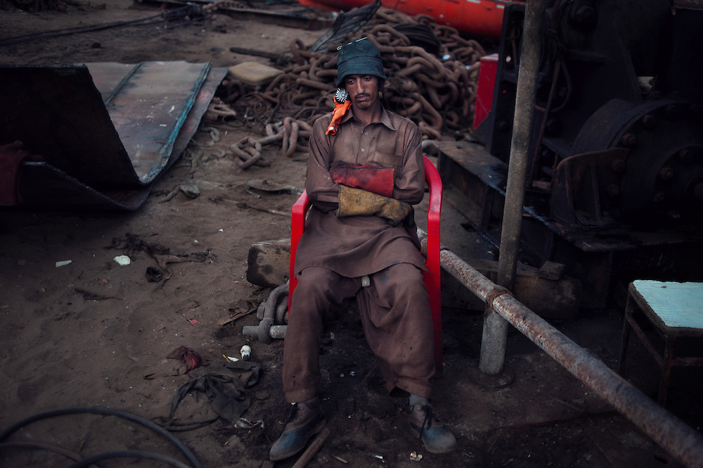 A man rests at the Gadani ship breaking yard, Balochistan Province, Pakistan on August 16, 2011.