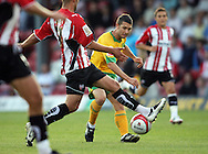 London - Tuesday, August 18th, 2009: Wes Hoolahan of Norwich City takes on Brentford during the Coca Cola League One match at Griffin Park, London. (Pic by Chris Ratcliffe/Focus Images)