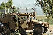 Israel, Upper Galilee, Metula, An Israeli Border Patrol Jeep and soldiers on the Lebanese border