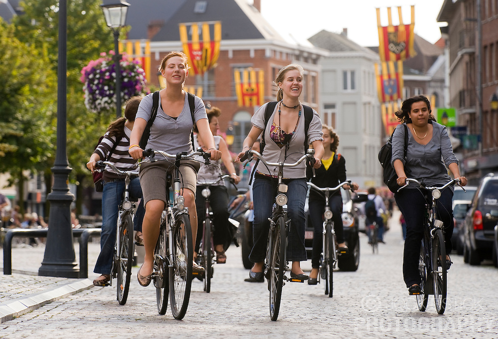 Pedestrians, bicyclists and motorists make their way along Ijzerenleen, one of the main shopping streets in the city center of Mechelen, Belgium, Thursday, Sept. 11, 2008. (Photo © Jock Fistick)