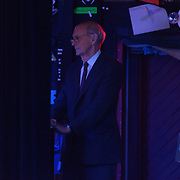 US Supreme Court Justice Stephen Breyer waits just off stage as he is introduced to speak in a WNES Show at The Music Hall In Portsmouth NH