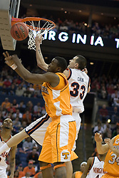 Virginia Cavaliers forward Jason Cain (33) reaches for a rebound against Tennessee Volunteers forward Wayne Chism (4) .  The #4 seed Virginia Cavaliers were defeated by the #5 seed Tennessee Volunteers 77-74 in the second round of the Men's NCAA Tournament in Columbus, OH on March 18, 2007.