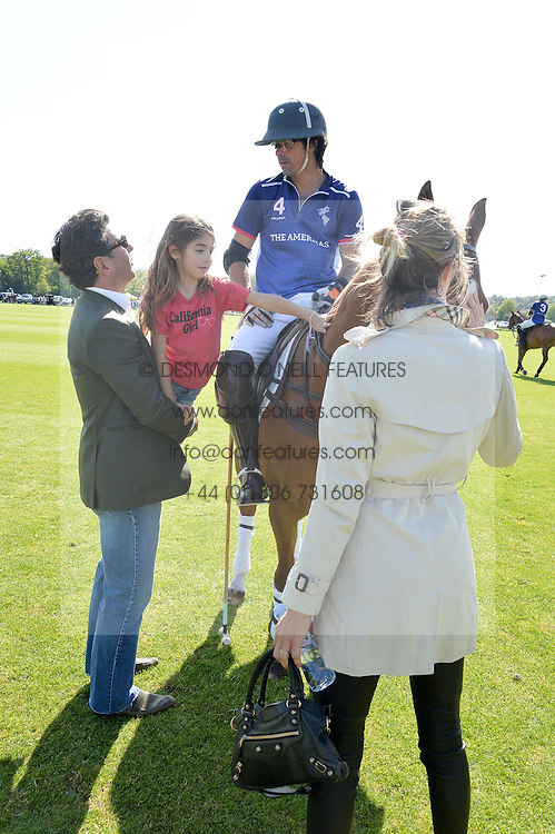 Left to right, GIORGIO VERONI holds his daughter VIOLET VERONI up to polo player  NACHO FIGUERAS and DELFINA FIGUERAS at the St.Regis International Polo Cup at Cowdray Park, Midhurst, West Sussex on 16th May 2015.
