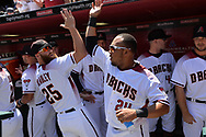 PHOENIX, AZ - APRIL 2:  Archie Bradley #25 and Yasmany Tomas #24 of the Arizona Diamondbacks high five prior to the game against the San Francisco Giants at Chase Field on Sunday, April 2, 2017 in Phoenix, Arizona. (Photo by Jennifer Stewart/MLB Photos via Getty Images) *** Local Caption *** Yasmany Tomas; Archie Bradley