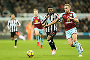 Charlie Taylor (#3) of Burnley and Christian Atsu (#30) of Newcastle United chase after the loose ball during the Premier League match between Newcastle United and Burnley at St. James's Park, Newcastle, England on 31 January 2018. Photo by Craig Doyle.