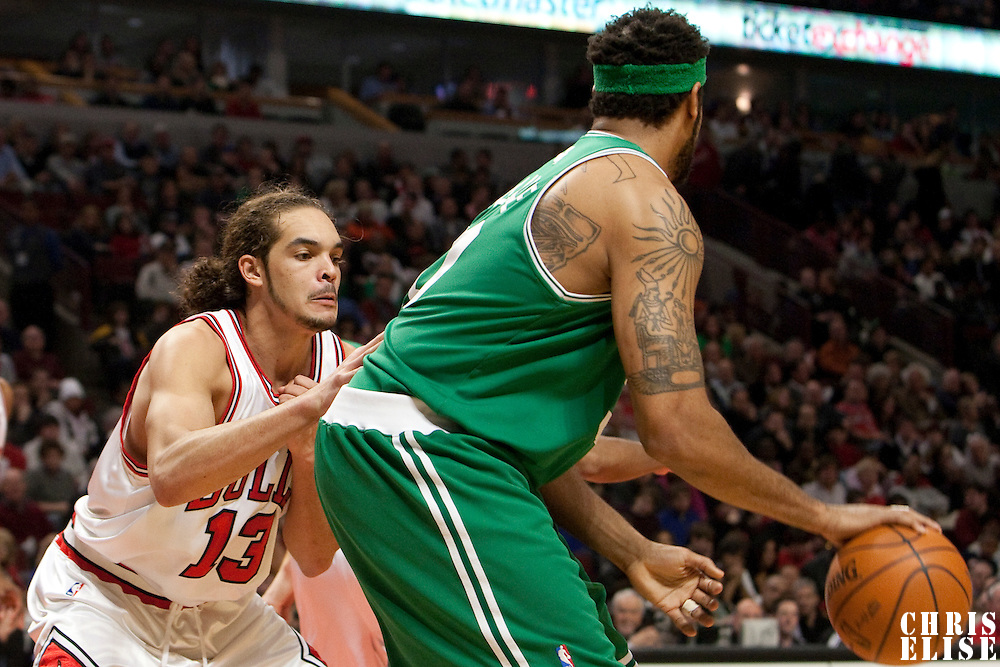 12 December 2009: Chicago Bulls center Joakim Noah defends on Boston Celtics center Rasheed Wallace during the Boston Celtics 106-80 win over the Chicago Bulls at the United Center, in Chicago, Illinois, USA.