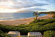 The Four Seasons Wailea beach cabanas at sunset in Maui, Hawaii
