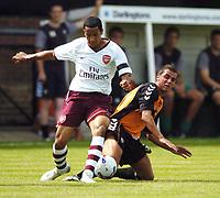 Photo: Jonathan Butler.<br /> Barnet v Arsenal. Pre Season Friendly. 14/07/2007.<br /> Theo Walcott of Arsenal and Nicky Nicolau of Barnet fight for the ball.