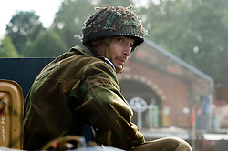Renecator portraying a British Paratrooper from the 6th Airborne Division prepares for a battle reenactment at Elsecar 1940s Weekend <br />
