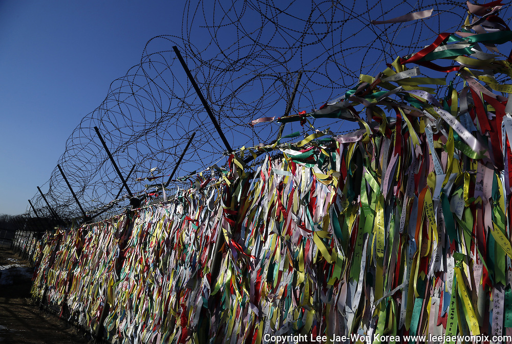 Ribbons containing visitors' messages for the peace and reunification of Korean peninsula are seen on a military fence near the demilitarized zone separating North Korea from the South in Paju, north of Seoul. Photo by Lee Jae-Won (SOUTH KOREA) www.leejaewonpix.com/