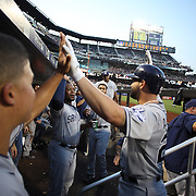 Justin Upton, (center), San Diego Padres, celebtrates a home run with team mate Yonder Alonso in the dugout tduring the New York Mets Vs San Diego Padres MLB regular season baseball game at Citi Field, Queens, New York. USA. 29th July 2015. Photo Tim Clayton