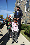 10/17/10 12:33:23 PM -- Darby, PA<br />  -- Democratic Congressional candidate Bryan Lentz listens as Ronia Marmon (L), and Roniya Marmon (R) recite the pledge of allegiance October 17, 2010 at a First Baptist Church in Darby, Pennsylvania. Bryan Lentz  faces Republican Pat Meehan  in the Nov. 2 general election.   --  Photo by William Thomas Cain/Cain Images