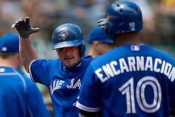 OAKLAND, CA - JULY 23:  Josh Donaldson #20 of the Toronto Blue Jays celebrates with teammates after hitting a home run against the Oakland Athletics during the fifth inning at O.co Coliseum on July 23, 2015 in Oakland, California. The Toronto Blue Jays defeated the Oakland Athletics 5-2. (Photo by Jason O. Watson/Getty Images) *** Local Caption *** Josh Donaldson