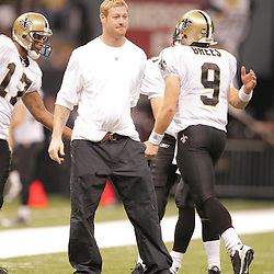 2008 September 28: Injured New Orleans Saints tight end New Orleans Saints tight end Jeremy Shockey greets quarterback Drew Brees on the sidelines following a Saints touchdown during the NFL week four game between the San Francisco 49ers and the New Orleans Saints at the Louisiana Superdome in New Orleans, LA.