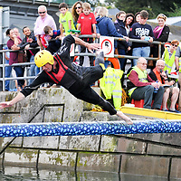 John Collins, Kinsale makes a grab for the flag at the Greasy Pole competition at the Water Carnival on Bank Holiday  Monday at the Kinsale Regatta.<br /> Picture. John Allen