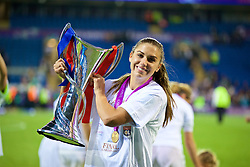 CARDIFF, WALES - Thursday, June 1, 2017: Olympique Lyonnais' Alex Morgan celebrates with the trophy after winning the UEFA Women's Champions League Final between Olympique Lyonnais and Paris Saint-Germain FC at the Cardiff City Stadium. (Pic by David Rawcliffe/Propaganda)