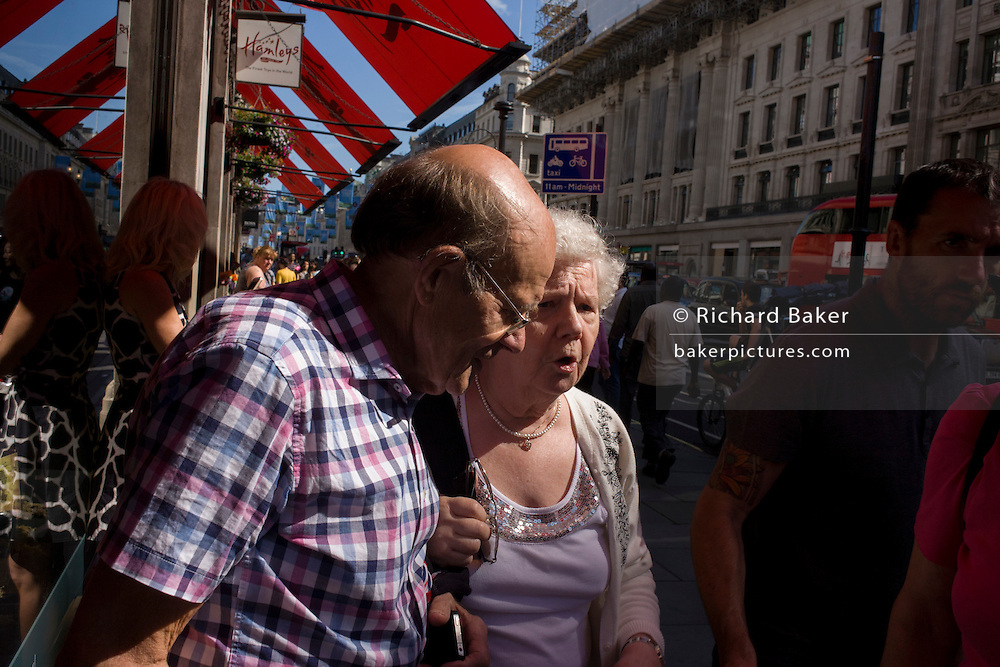 Elderly couple feeling the heat during a hot summer in central London.