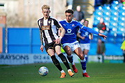 Chesterfield forward Jacob Brown (44)  and Notts County defender Daniel Jones (23) during the EFL Sky Bet League 2 match between Chesterfield and Notts County at the Proact stadium, Chesterfield, England on 25 March 2018. Picture by Nigel Cole.